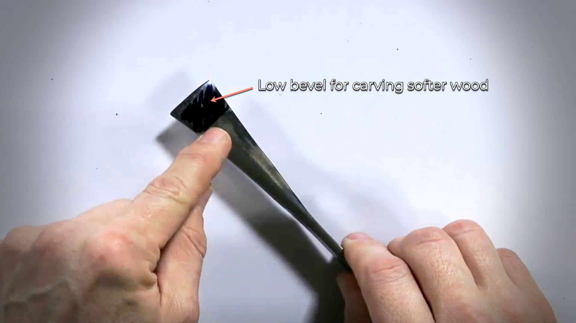 Low bevel of woodcarving tool for carving softer wood like basswood or aspen